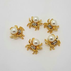gold and pearl spiders nail charms